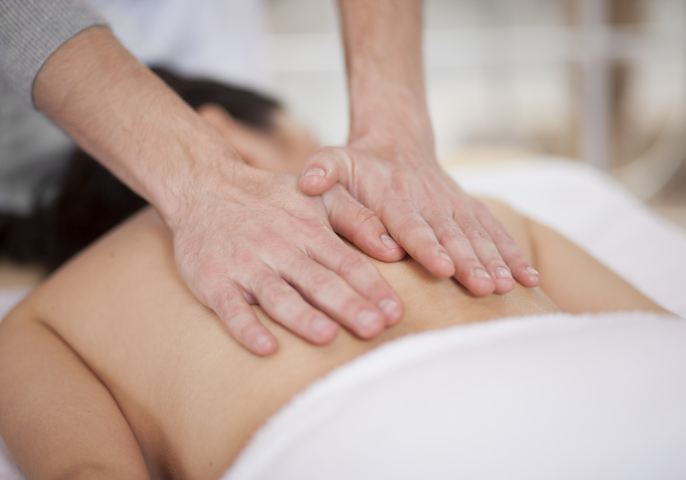 massage therapist performing massage