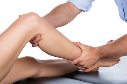 massage therapy kelowna - Physiotherapist massaging patient